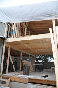 When a large tarp is part of the site protection required, you may want to stay elsewhere during your remodel.