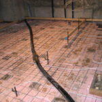 The basement was dug down, then insulation and radiant heat added before the new slab was poured.