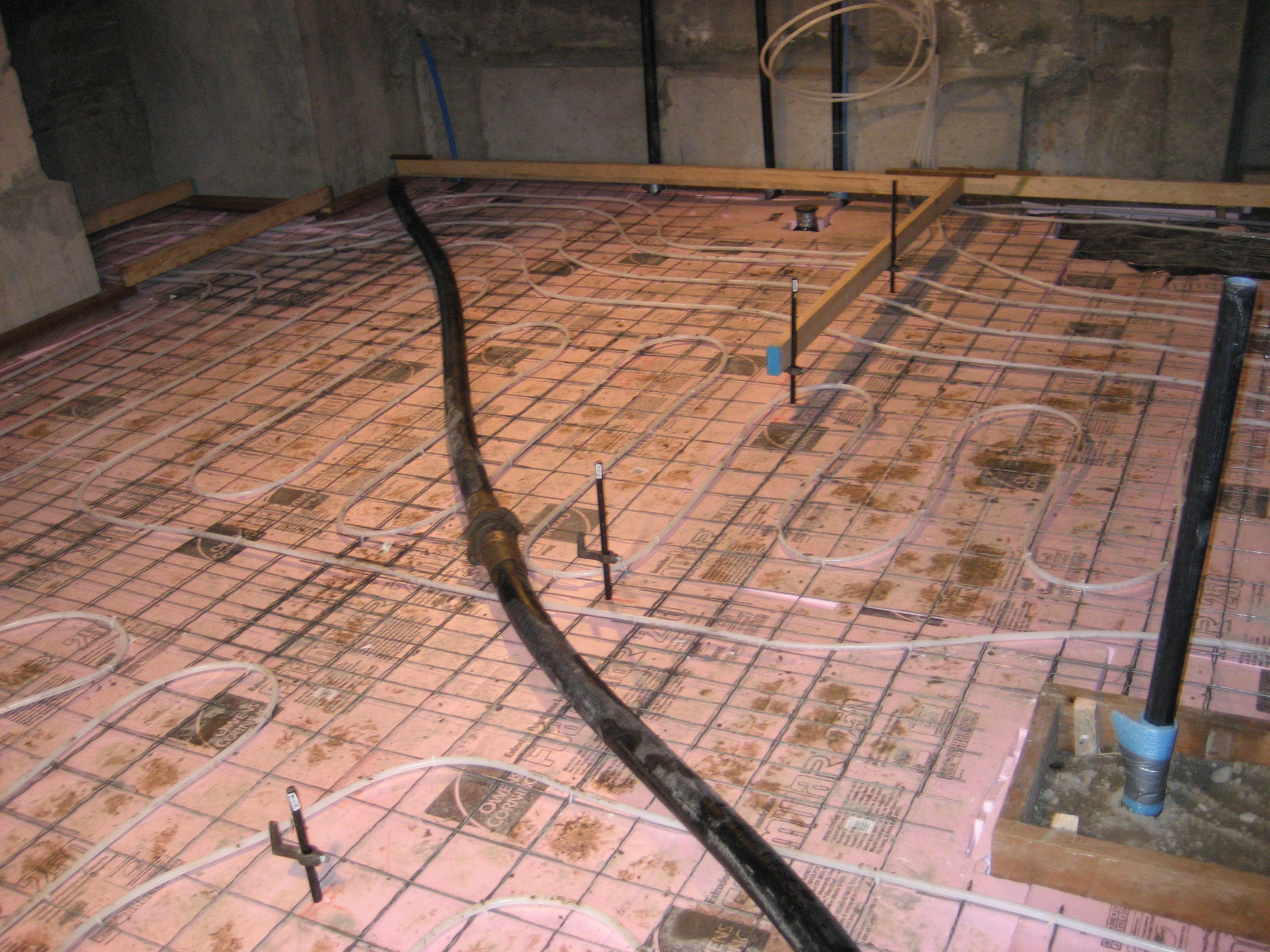 The Basement Was Dug Down, Then Insulation And Radiant Heat Added Before  The New Slab