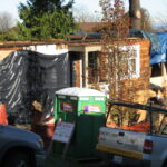 Tarps on the job: the sure sign of construction during the winter in Seattle.