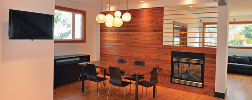 That boring dining room is no more. The horizontal cedar and fir on the fireplace wall warm up the room, and integrate the two-sided fireplace into the room. West Seattle major remodel