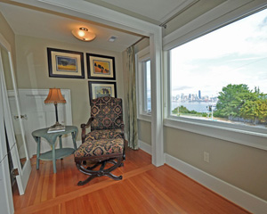 With a new master closet, this former closet space gets a new mission: reading nook.  With a view of the city like this, it might be easy to get distracted, though.