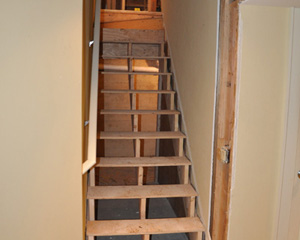 The stairs to the basement also get a remodel.  Formerly described as treacherous, these expanded treads end up navigable and beautiful with some carpet installed.