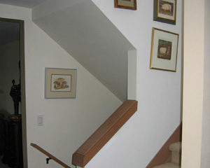 Before: Classic '80s stairs with knee walls and carpet had to go.