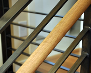 'and the steel railings and oak handrail carry the same finishes through from the floor below.