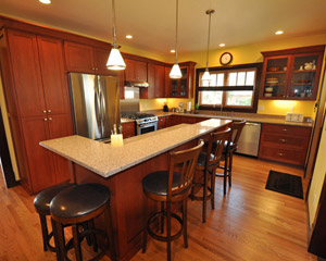 The new kitchen is spacious, with a center island and raised counter.