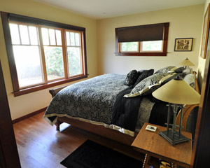 A light-filled master bedroom looks out on the fenced backyard'private but spacious.