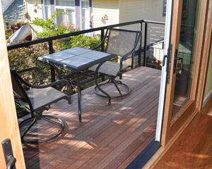 By removing that fireplace, it allowed the entire deck to be resurface and now accessed via the sliding doors. New steel stringer railings bring a contemporary upgrade and lacewood decking is a visual counterpoint to the poplar flooring inside.