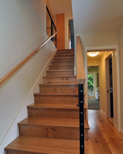 ... Now Steel Stringer Railings With Fir Caps Grace The Stairs, And Knotty  Oak Treads Lead ...
