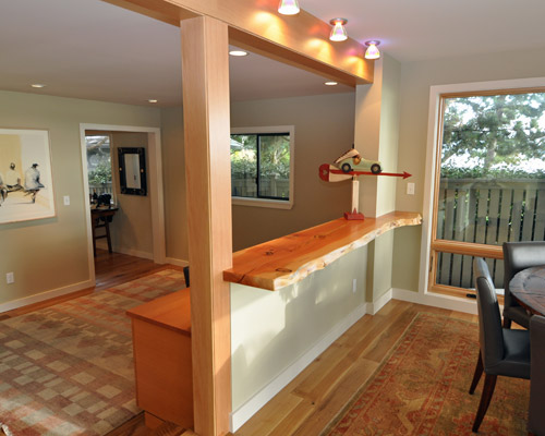 the wall divider here is topped with a live edge fir slab that doubles as seating the dining room - Dining Room Remodel