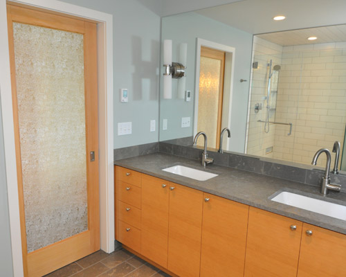 the new master bathroom has the same fir cabinets as downstairs and limestone countertops - Seattle Bathroom Remodeling