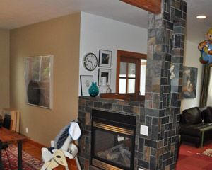 The previous incarnation had the fireplace tiled - badly and set off visually from the dining area.