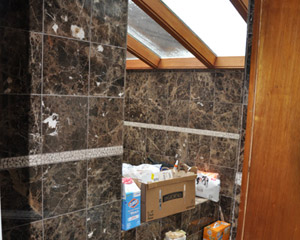 More importantly, this giant spa was useless on the main floor for a family with young kids. �The 200sf room became a place for the cat box.