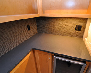 We especially like the tile backsplash and the under cabinet lighting.
