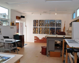 P's studio, while technically a daylight basement, is truly filled with light, from windows and doors to the South and clerestory windows to the North.  The West wall was left purposely windowless to allow art pieces to be hung and worked on there