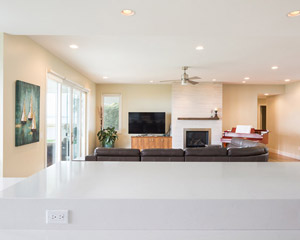 The expansive kitchen, dining room and living room areas are the heart of this home, with open sight lines across almost 1000sf of space.  This open concept allows extended family to gather and enjoy time together while enjoying a wall of water-facing windows and doors.