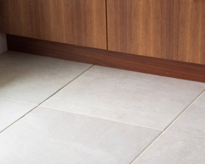 Tile also features prominently in the kitchen and dining room areas, chosen specifically knowing how much sand may be tracked into the house.