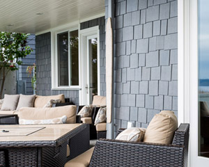 The covered patio on the water side of the home provides plenty of sheltered seating and an unobstructed view.