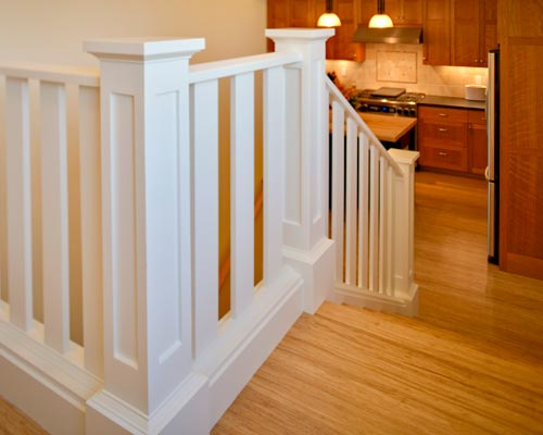 Elegant White Railings Lead From The Kitchen Up Half A Floor To The Master  Bedroom,