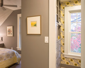 The use of built-in cabinets at the bed area makes the bedroom cozy and functional.