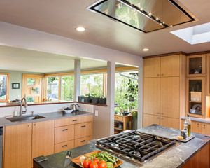 The island stove employs an unusual flush-mount hood for ventilation.  This was chosen to avoid blocking the expansive view of the Olympics from that spot in the kitchen.