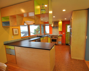 clean lines, green materials, and brightly painted walls. A unique and playful mid-century modern kitchen, Seattle kitchen remodel