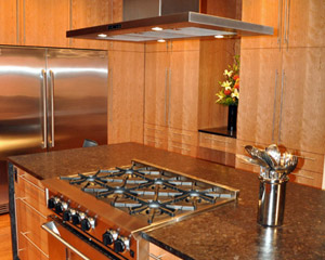The range hood required a custom-built shroud to create a seamless connection with the ceiling.