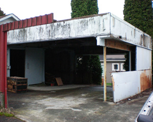 The old garage had been worked on by family, but it had seen better days.  The extension on the original garage was taking up valuable parking space, and all the materials were rotting and rusting.