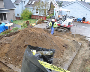 After removing the old garage, the new footings and foundation were excavated in preparation for pouring concrete.