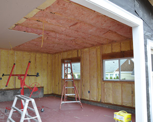 This garage includes space for both vehicles and a shop area, and was wired to accommodate large power tools.  The installation of insulation and sheetrock inside provides a finished shop space that is both comfortable and attractive.