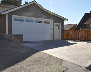From the alley,  vehicles can easily enter and exit the garage, and there is enough space to park additional vehicles outside.  A practical West Seattle garage remodel